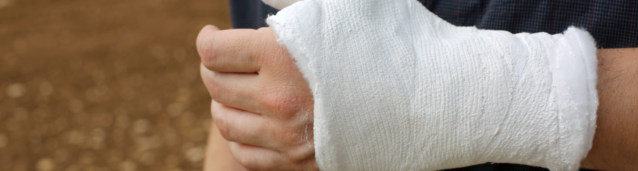 Man with bandage on his hand after accident ready to make a RIDOOR report