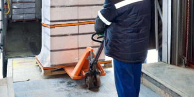 Warehouse worker removing stock from van