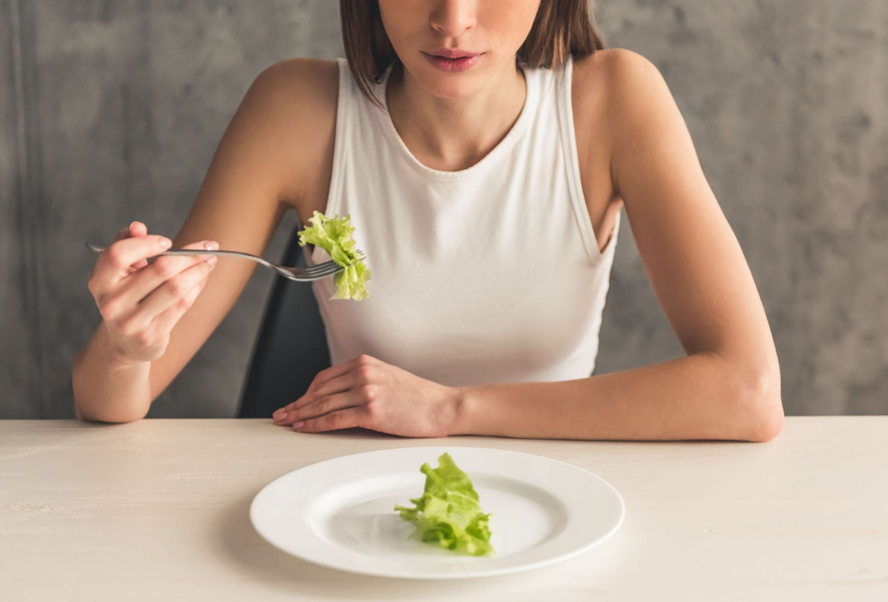 Woman struggling with eating disorder
