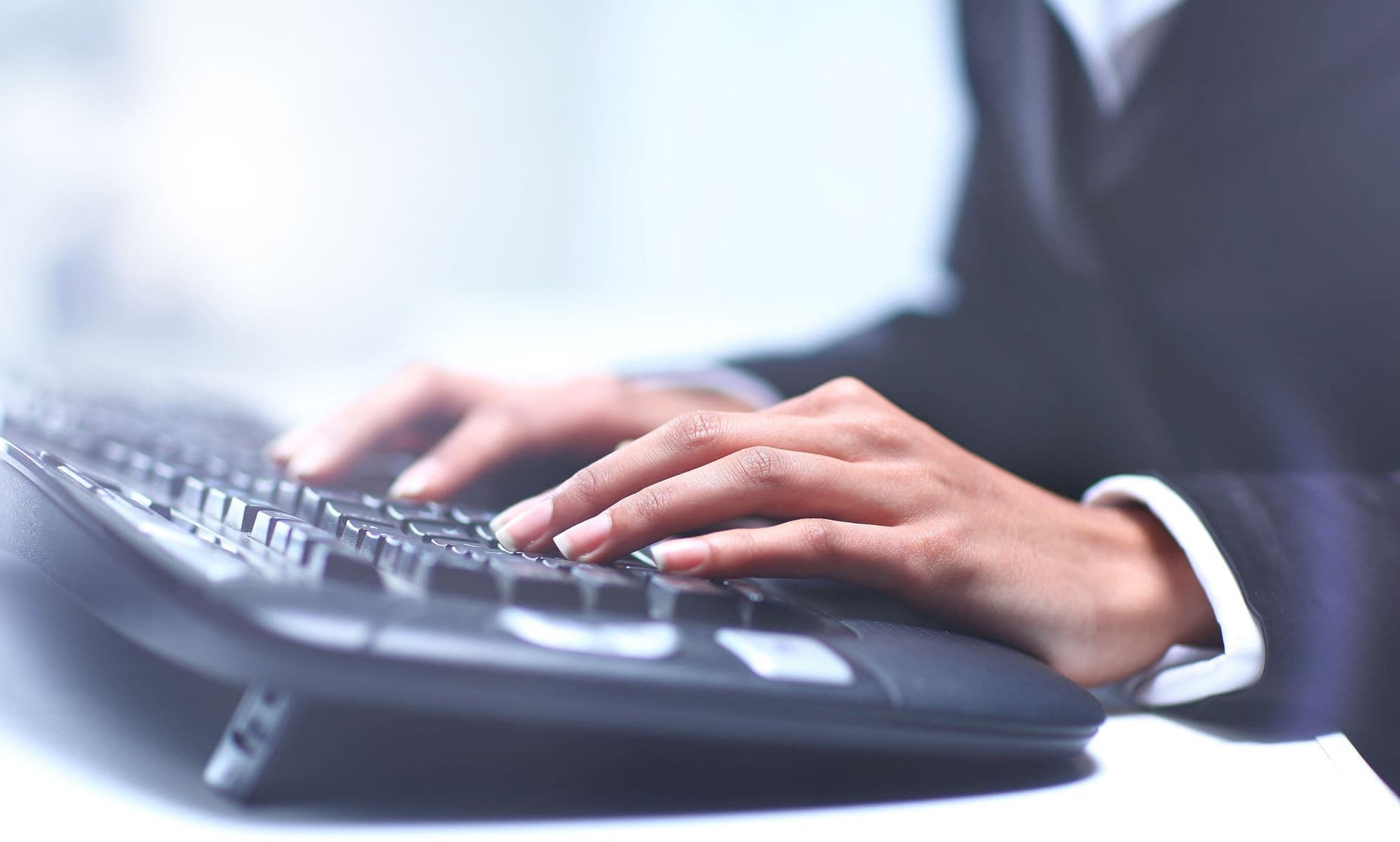 Worker typing on keyboard