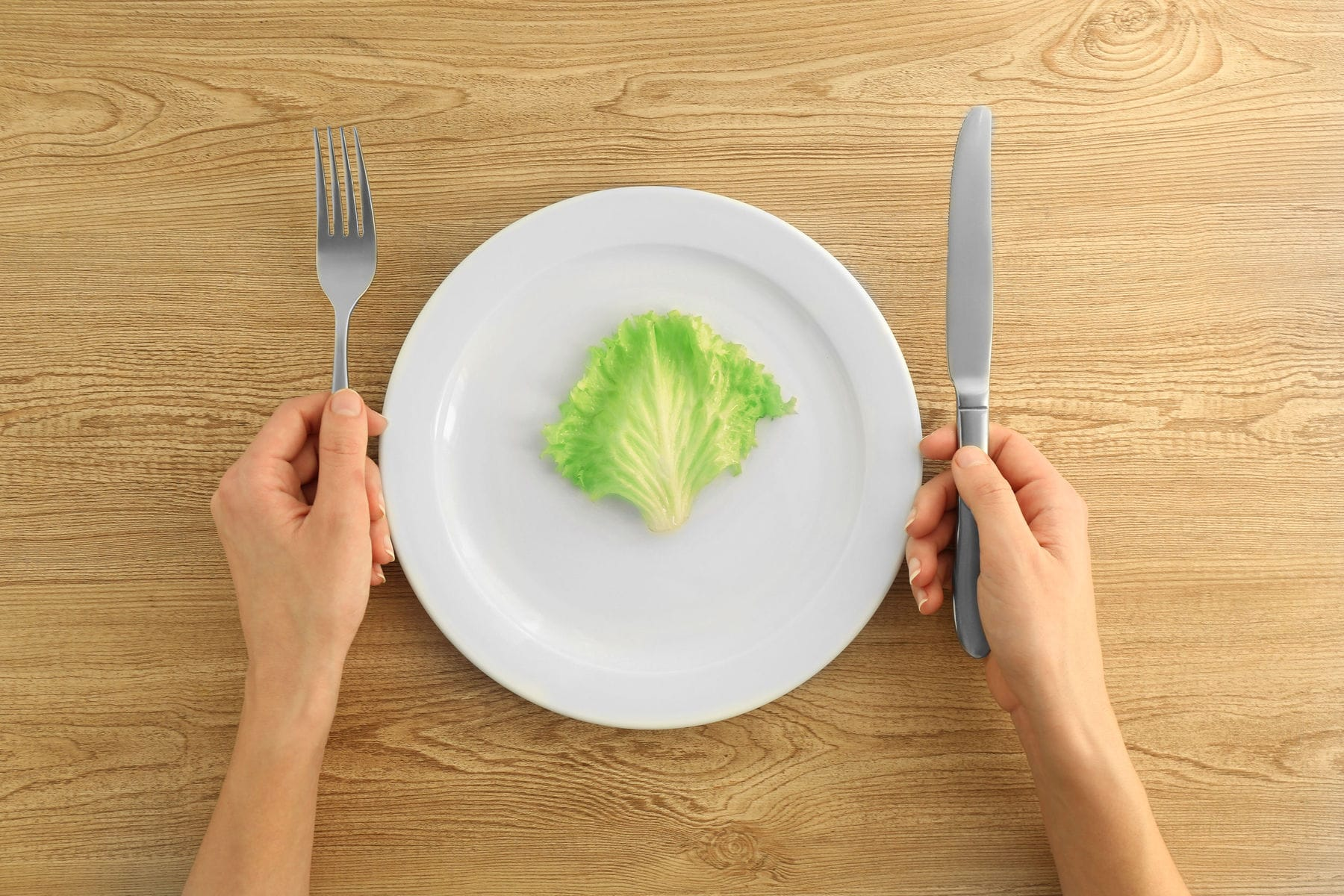 Person with eating disorder eating