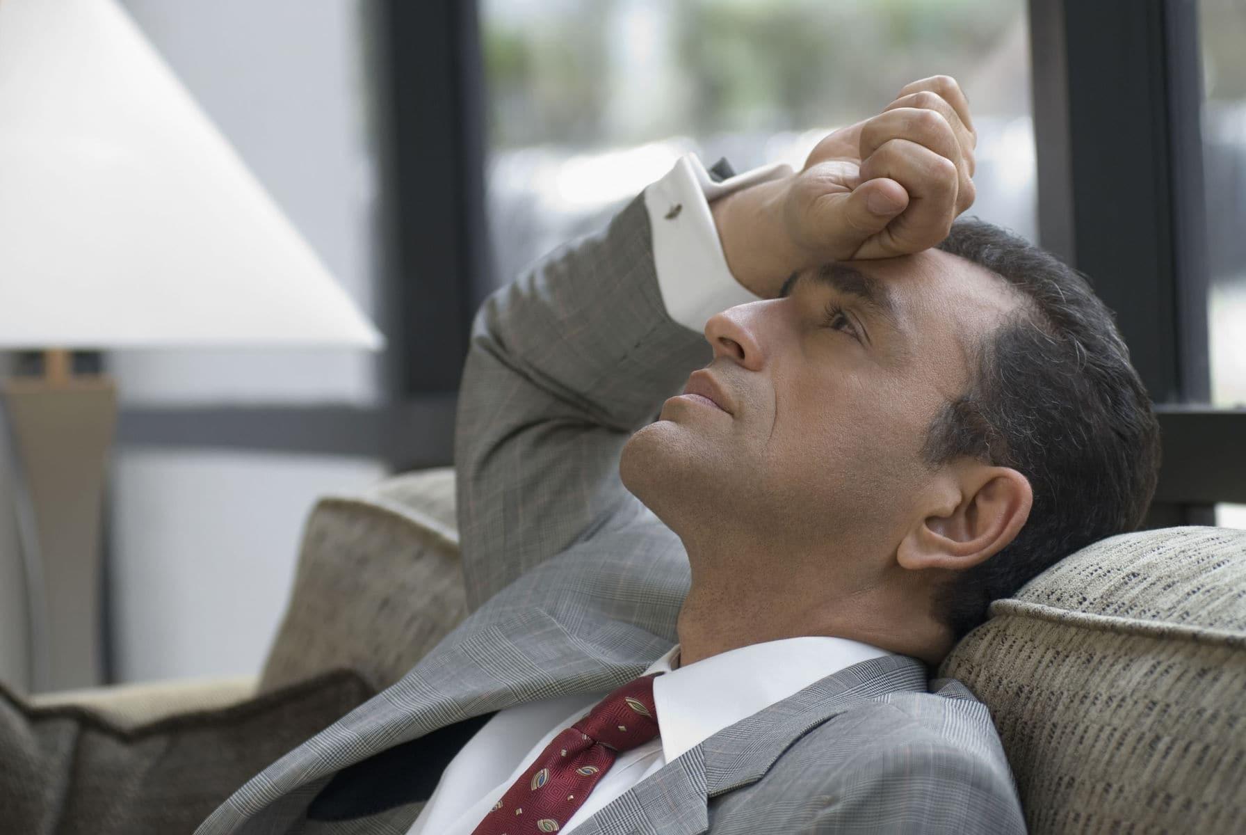 Man sat overwhelmed