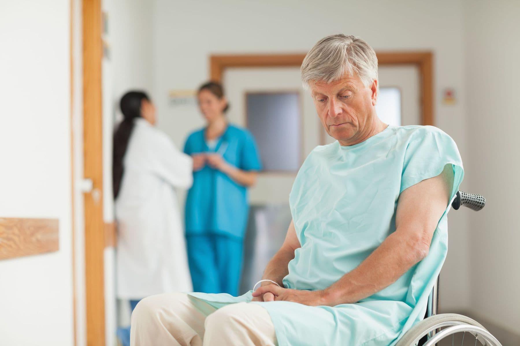 Sad elderly man with dementia in the corridor of hospital