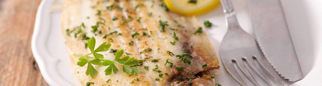 Fresh cod fish cooked with herbs and lemon