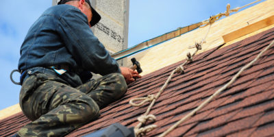 Man working at height on a roof