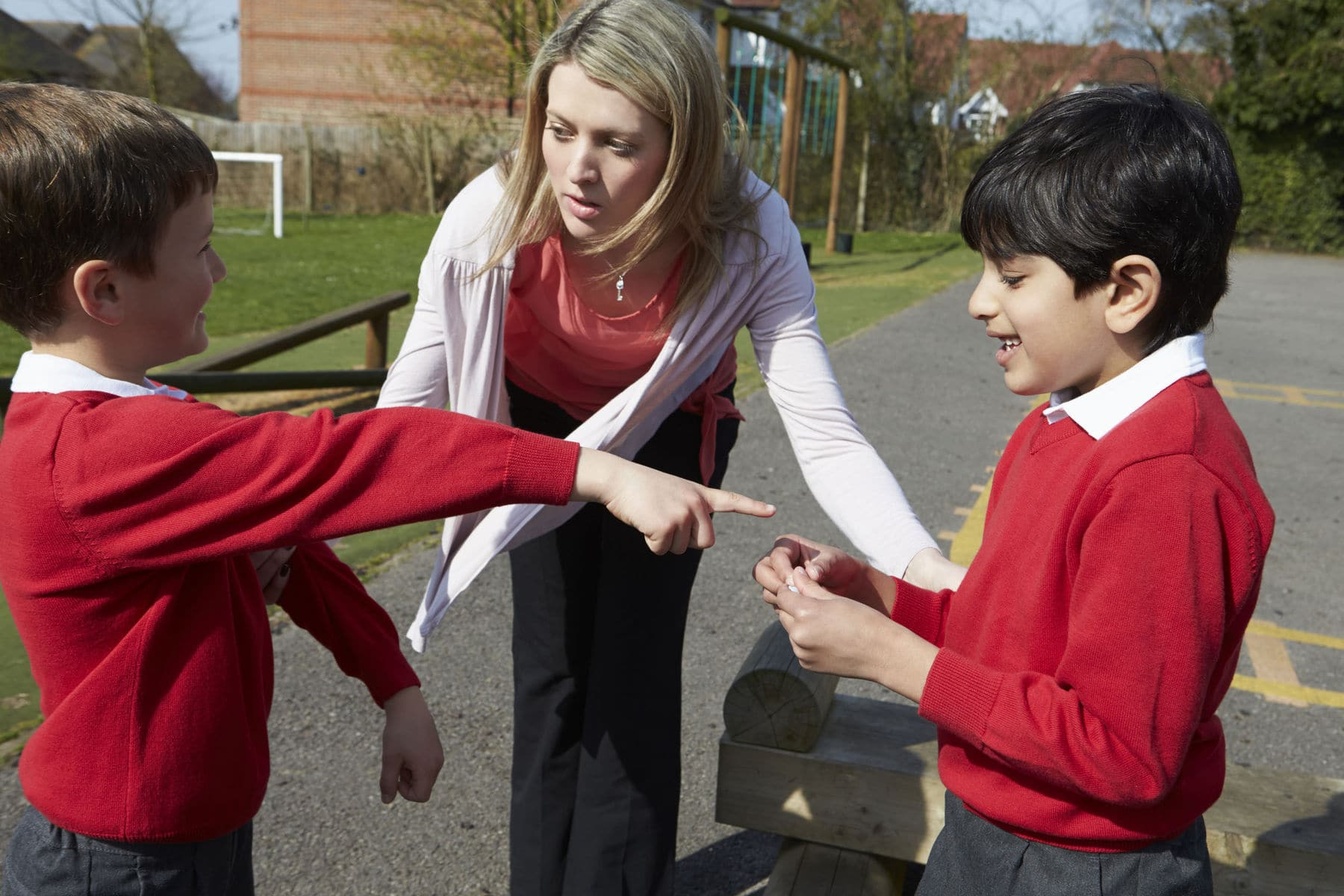 Teacher stopping fight between students with challenging behaviour.