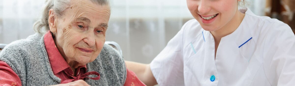 Senior women being looked after by her female care nurse