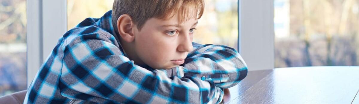 Boy struggling with mental health problems