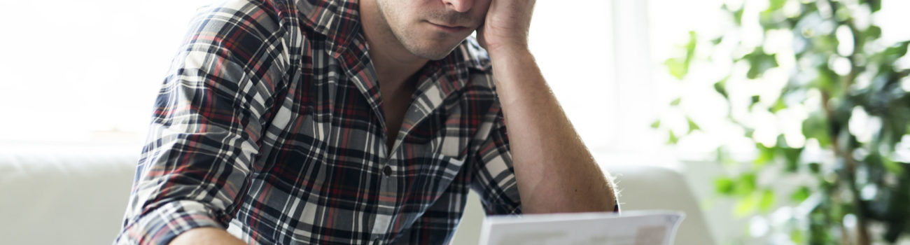 Men's Mental Health - Man struggling with financial worries
