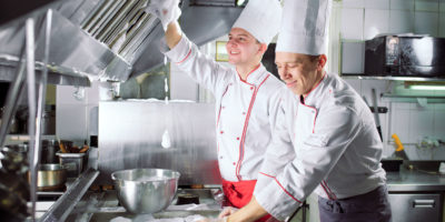 Chefs cleaning as you go after busy day