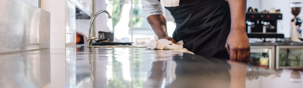 Chef using cloth to clean as you go