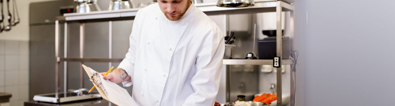 Chef working in a busy kitchen using FIFO method to find ingredients