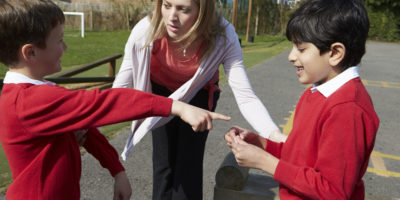 Teacher managing behaviour in the classroom