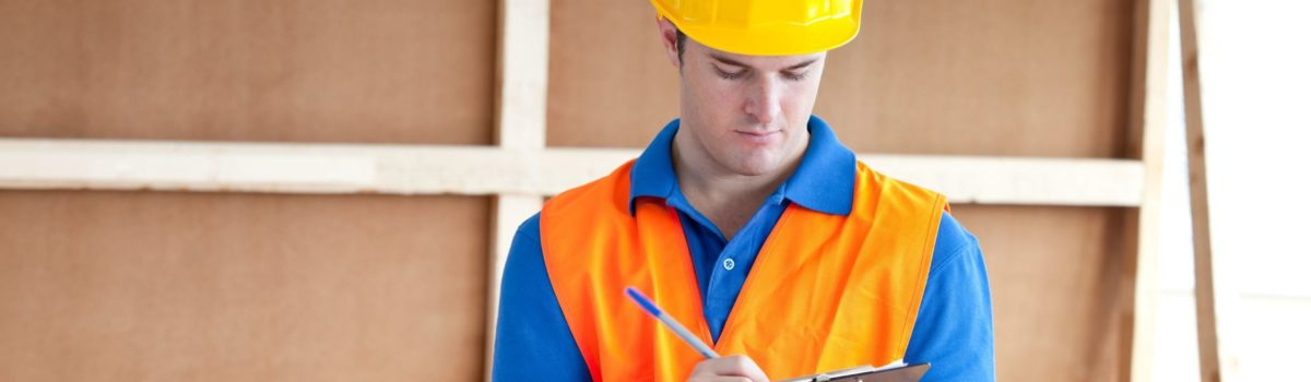 Construction worker checking his PPE checklist