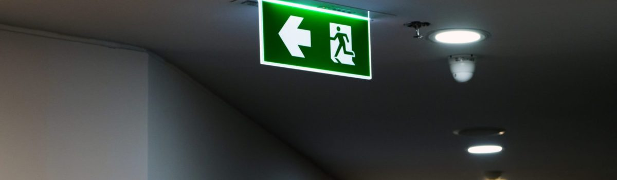 Florescent Emergency exit signs displayed in office