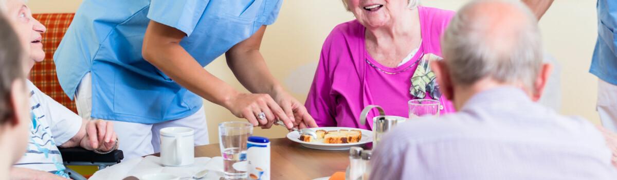 Nurse with elderly patients, ensuring their welfare is prioritised