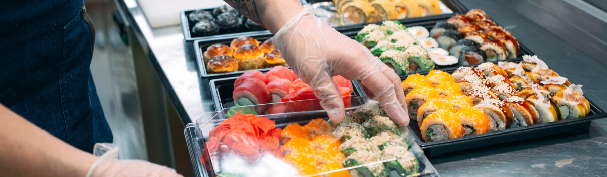 Chef in hospitality preparing food with gloves on to prevent cross contamination