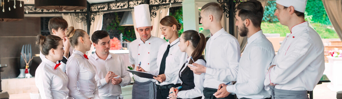 Restaurant manager and his staff reviewing their HACCP plan