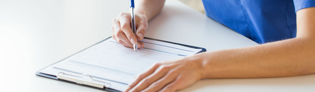 Nurse writing out updated care plan for service user