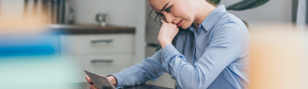Woman struggling with bullying in the workplace upset at home