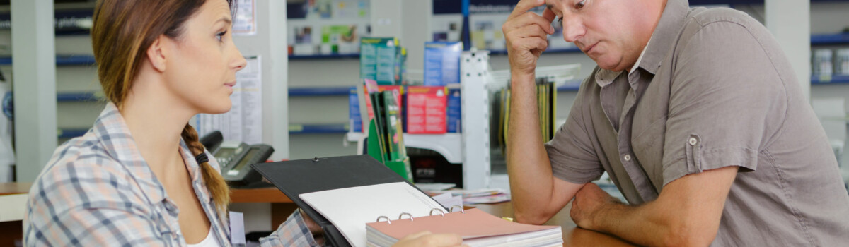 Shop assistant dealing with customer