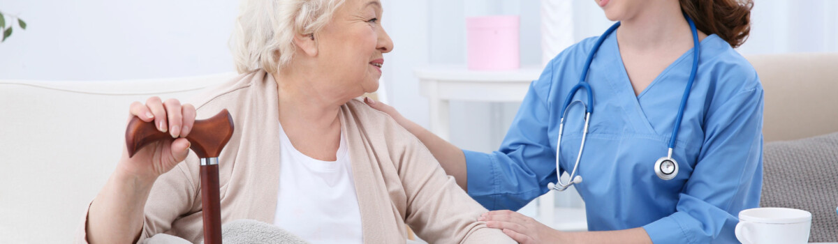Nurse sat with elderly person before capacity assessment