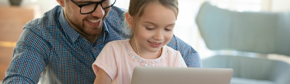 Parent Practising Facebook Safety With Child