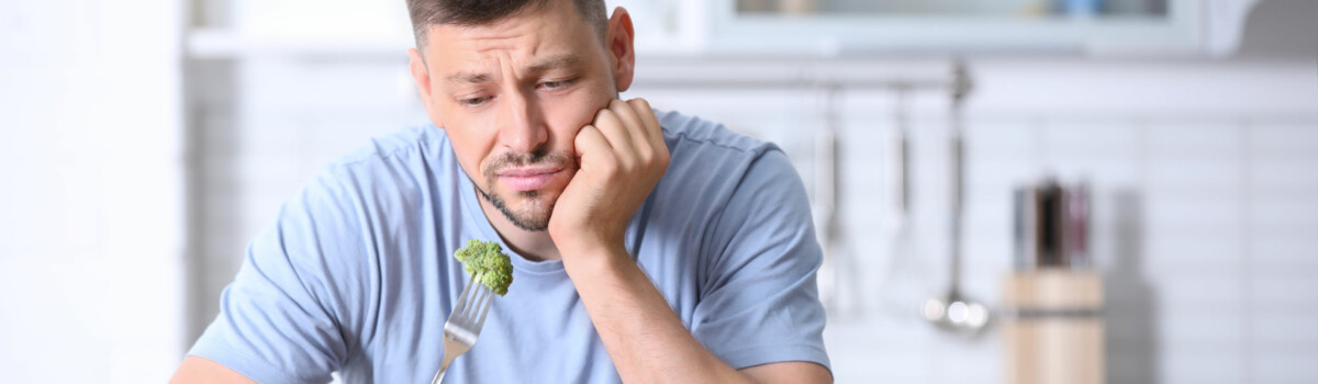 Man struggling with an eating disorder, restricting his calorie intake