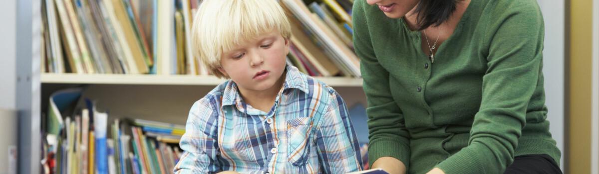 Teacher safeguarding young vulnerable child