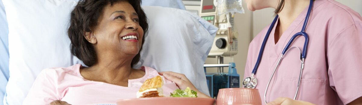 Nurse serving food to vulnerable patient in hospital