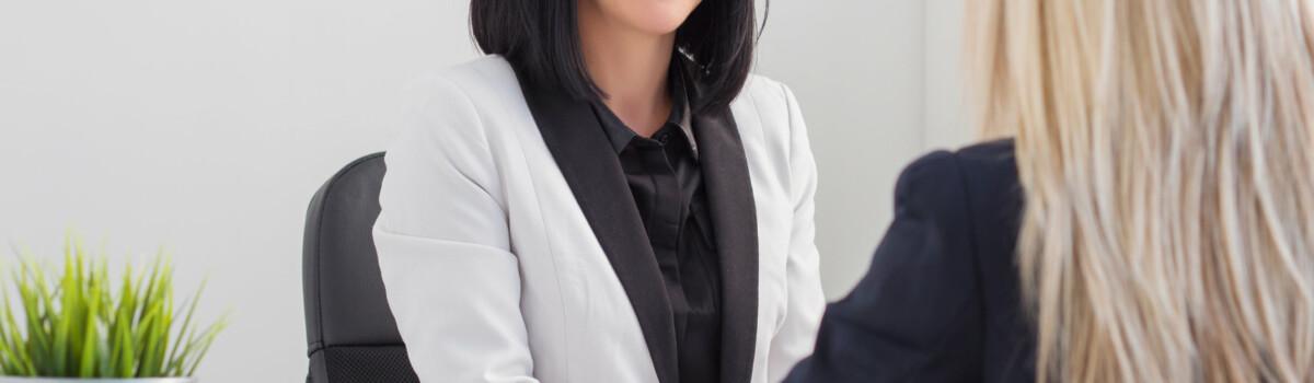 Headteacher recruiting new member of staff, following safer recruitment process