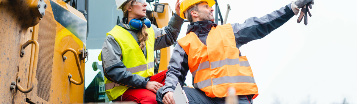 Construction workers assessing risks at work