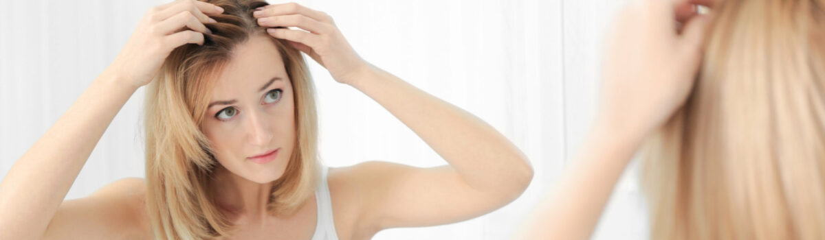 Girl checking her hair
